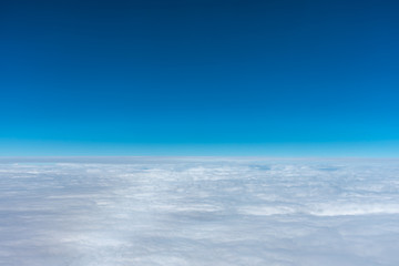 Dark blue sky horizon, up in the air. viewed from an airplane window.