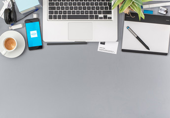 Desk with Laptop and Smartphone Mockup