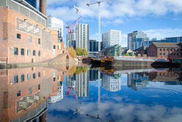 City of Birmingham in Great Britain with a beautiful view on the city wharf with a reflection in the canal water