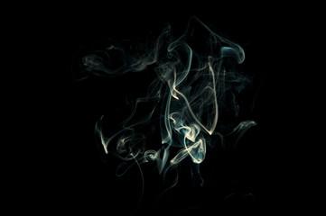 Thin wisps of smoke on a black background