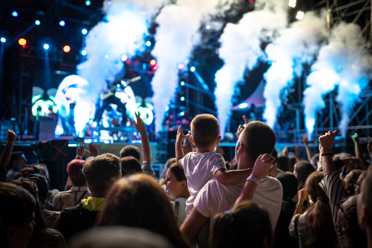 Concert crowds with adults and children