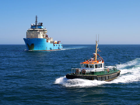 Harbour Pilot Boat underway escorting offshore vessel to harbour.