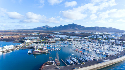 Tuinposter Canarische Eilanden Aerial view of yachts, sail boats, catamarans docked in charming Rubicon marina, Playa Blanca tourist seaside resort, Lanzarote, Canary Islands, Spain .