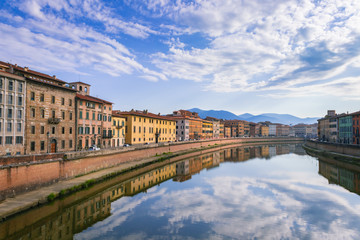 View of the river Arno lined with colorful buildings in the city of Pisa, Pisa, Tuscany, Italy, Europe