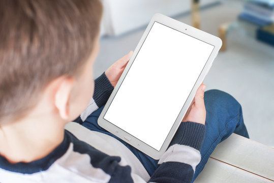 Boy holding tablet with blank screen for app, web site presentation.