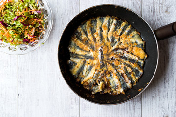 Fresh Fried Sardines / Anchovy Hamsi Tava in Pan on Wooden Surface.