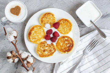 White Cup of Coffee Cappuccino with Heart Pattern of Cinnamon, Cottage Cheese Pancakes with Raspberries, Healthy Breakfast, Traditional Food, Valentines Day