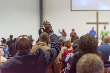 African American Man at Church with His Hand Raised Fotomurales
