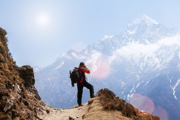 Mountaineer photographing a beauty of a nature at Himalayas mountain Wall mural