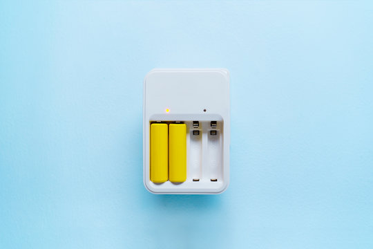 Picture of charger with yellow batteries