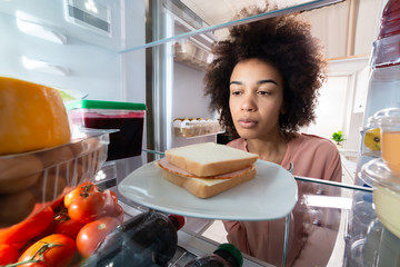Woman Searching For Food In The Refrigerator