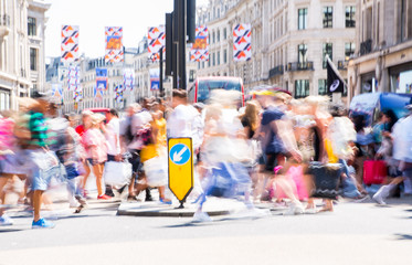 London, UK. Beautiful motion blur of people, walking in the Regent street in summer day. Busy life of the capital.