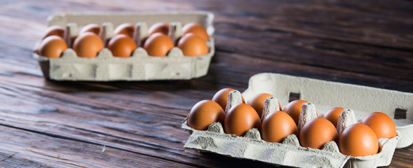 Fresh brown eggs on rustic table.