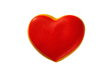 Closeup gingerbread red heart cookie as a symbol of Valentines day isolated at white backkground.