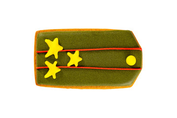 Gingerbread coolie as a russian army shoulder strap isolated at white background. Concept of 23 february national holiday.