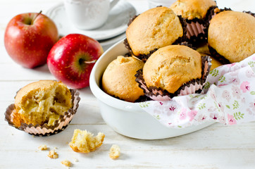 Apple muffins on a white wooden background