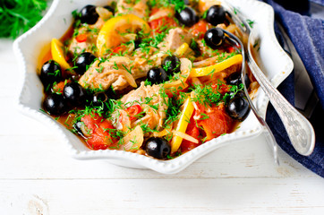 Chicken (turkey) stewed with tomatoes, olives and lemon in Italian style