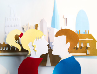 Paper cut design. Modern city with skyscrapers and young couple on a date. Abstract background