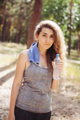 Young woman drink water from bottle and sport outdoors, healthy lifestyle
