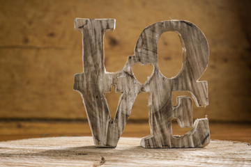 Word love in wood type, love concept.