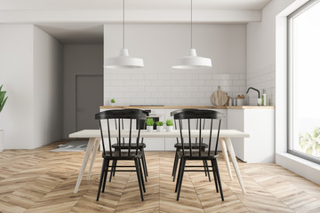 Small white kitchen with table
