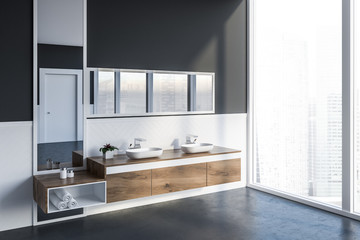 Side view of gray bathroom with double sink