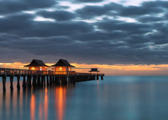 Wall Mural - Reflections of Naples Pier on the Gulf of Mexico at sunset from Naples, Florida