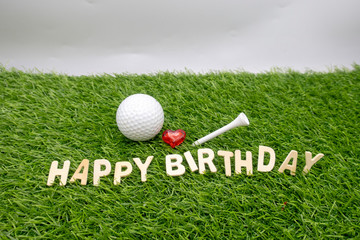 Happy birthday to golfer with golf ball on green