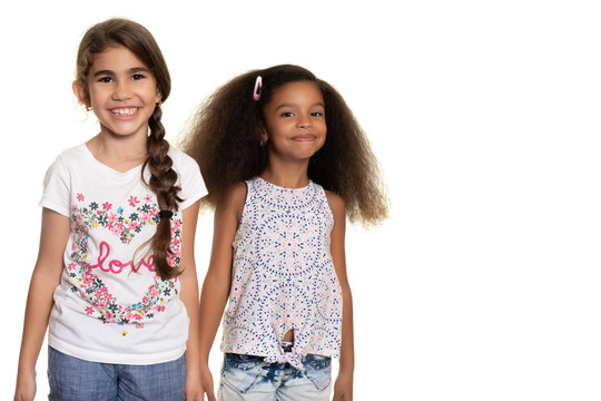 Hispanic and african american small girls  on a white background