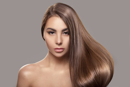 Portrait of a beautiful woman with shiny straight hair. Hair care asian woman