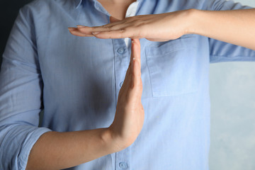 Woman showing hand sign, closeup. Body language