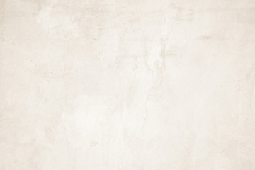 Cream concreted wall for interiors texture background.