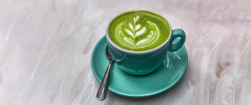 Matcha latte green tea cup background panorama banner.