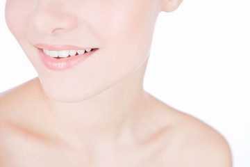 Studio beauty shot with young smiling woman with perfect teeth