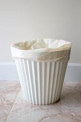 white plastic rubbish bin