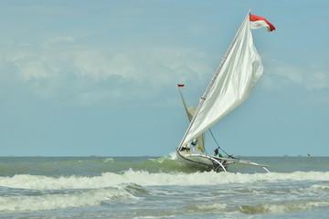 Waves Beach and Sail boat