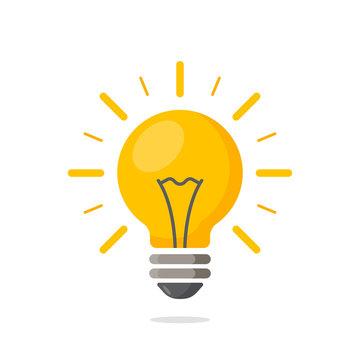 Light bulb with rays shine. Energy and idea symbol.