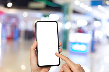 young woman holding hand smartphone on Shopping center blur background