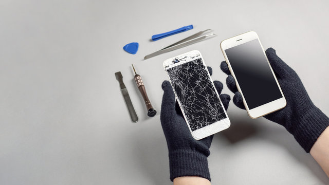 Technician or engineer prepairing to repair and replace new screen broken and cracked screen smartphone prepairing on desk with copy space