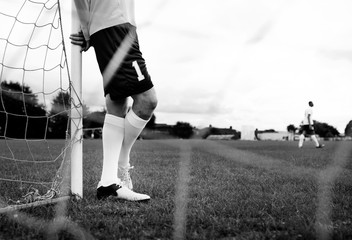 Male goalkeeper standing by the goal