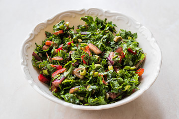 Chopped Parsley Salad with Tomatoes and Onions in Ceramic Bowl on Marble Surface.