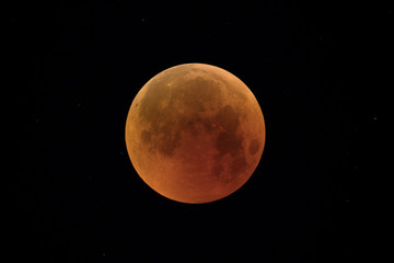 Full Moon eclipse day 2018,with orange color of the shadow, taken with large newtonian telescope in black background.