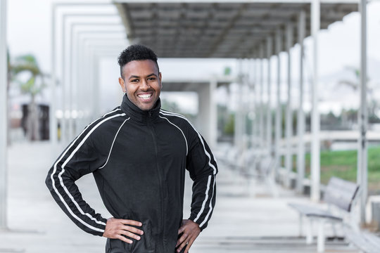 Black personal trainer looking at camera
