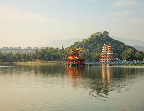 Beautiful red and gold temple on Lotus Pond in morning