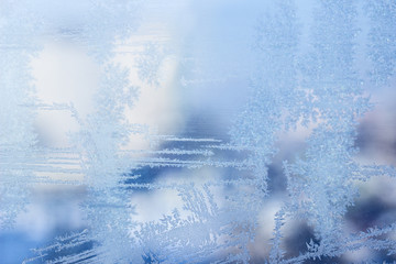 thin shiny lines bewitching ice patterns on a frozen winter window close-up