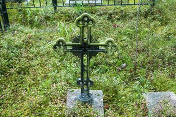Cross at old beautiful semetery in Finland.