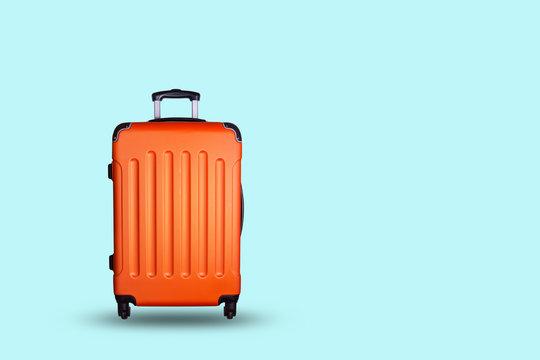 Travel suitcase on blue background