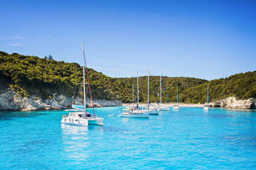 Vacations in Greece. Beautiful bay with sailing boats yachts near the Antipaxos island