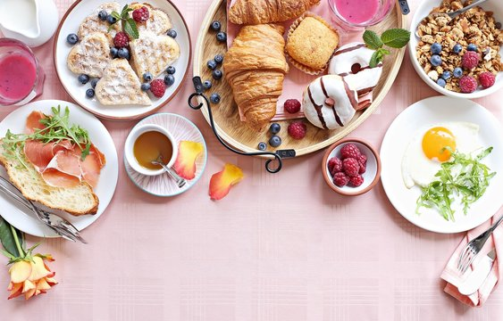 Brunch. Festive family breakfast set for Valentines day, Mothers day or Easter. Pink background