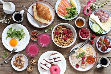 Brunch. Family breakfast or brunch set served on rustic wooden table. Overhead view